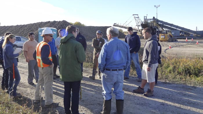 "John Pulasky speaks to RMC stu­dents at West­ern Sugar Co-op ""beet dump"" just out­side of Hunt­ley, Montana."